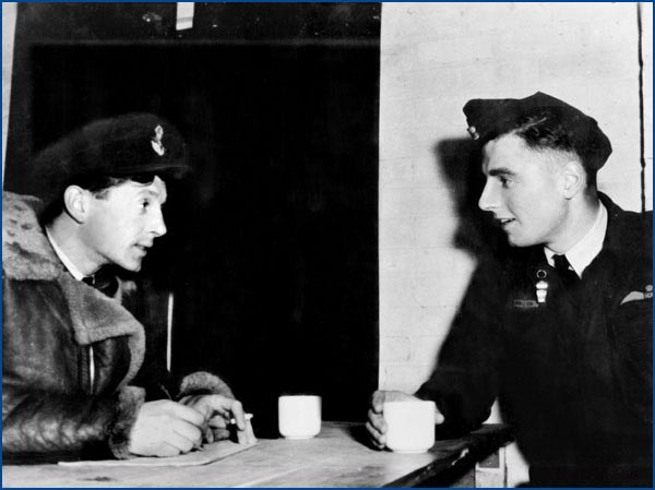 Clive Stinton with Charles Appleton during a post raid debriefing.